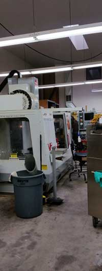 CNC Mills used to grind the surface of industrial machine parts and tools