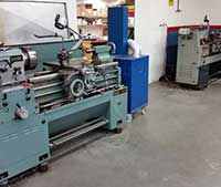Lathes used to grind the surface of industrial machine parts and tools