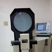 An optical comparator used to inspect custom parts